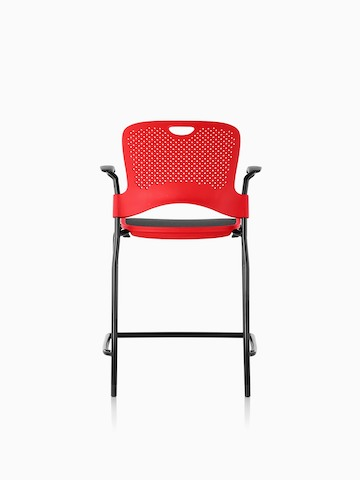Red counter-height Caper Stacking Stool with a black suspension seat, viewed from the rear.