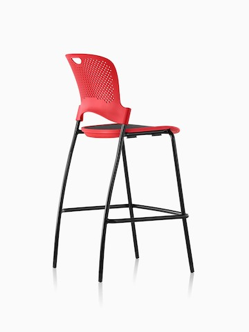 Three-quarter rear view of an armless red Caper Stacking Stool with a black suspension seat.