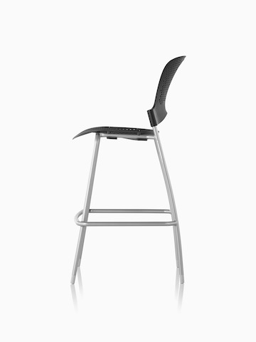 Profile view of an armless black Caper Stacking Stool.