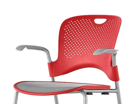 Upper half of a red Caper Stacking Stool with a gray suspension seat, viewed from a 45-degree angle.