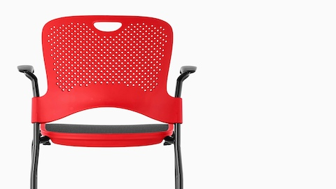 Red Caper Stacking Stool with a black suspension seat, viewed from the rear.
