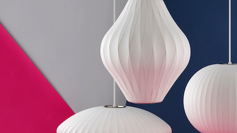 Three white Nelson Bubble Lamps. Select to go to the Nelson Bubble Lamps product page.