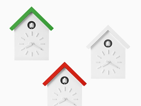 Three contemporary cuckoo clocks with green, orange, and white roofs. Select to go to our decor pages.