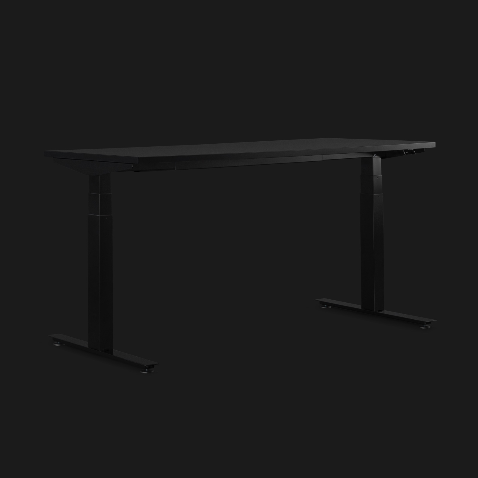 Dark grey height-adjustable Nevi Gaming Desk shown on an angle on a black background.