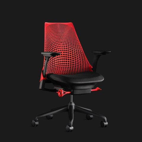 A red Sayl Chair, shown at an angle, on a black background.