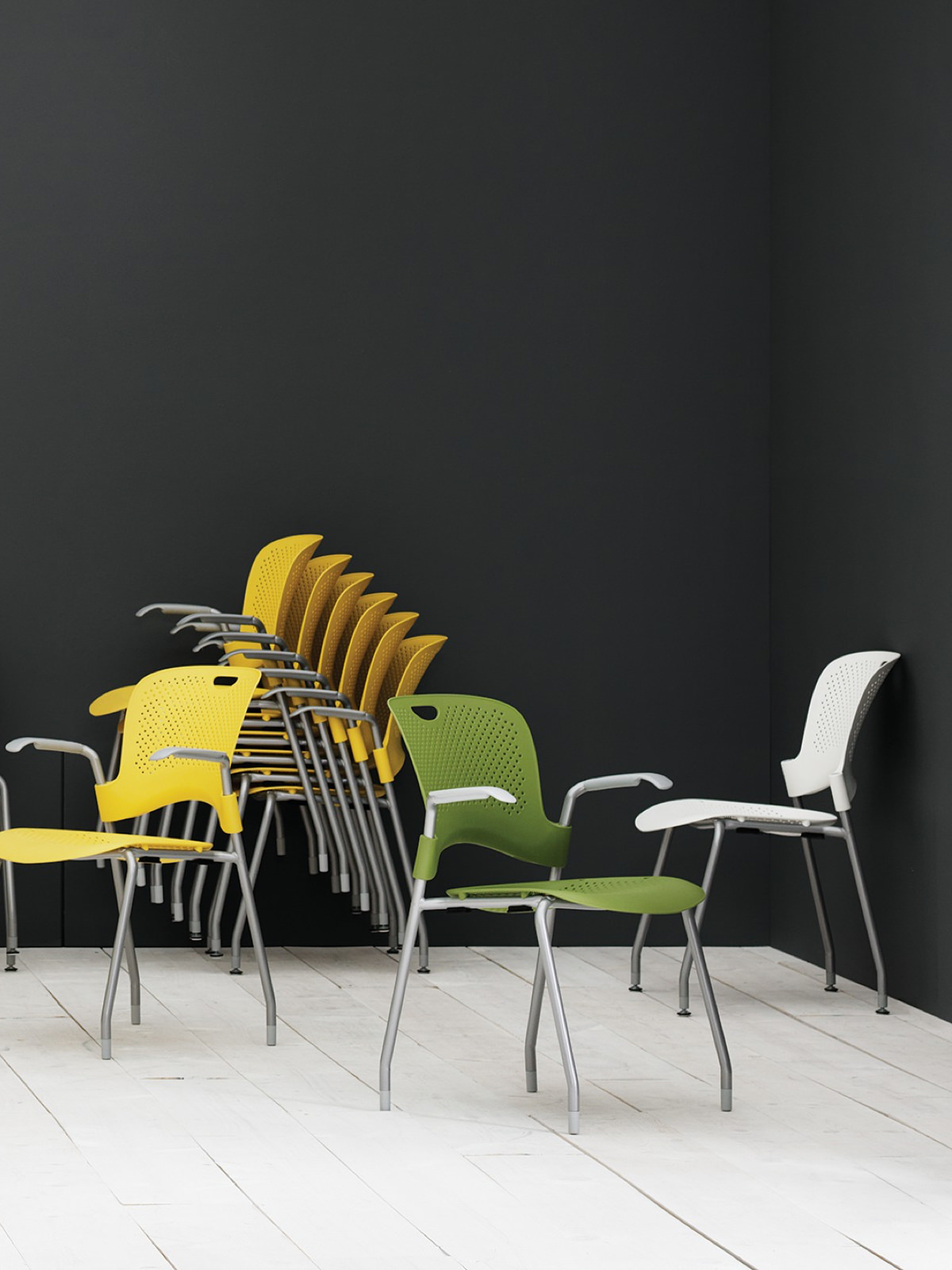 Yellow, green, and white Caper Stacking Chairs.