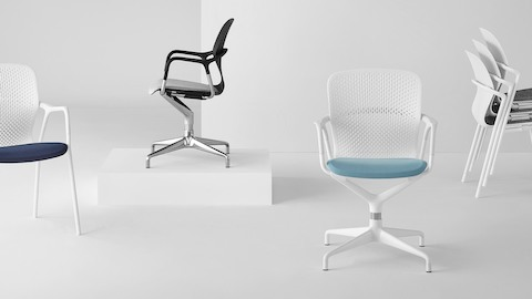 White and black Keyn side chairs, including the stackable model.