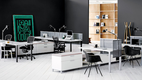 White Canvas Storage units delineate space and provide guest seating in an open office.