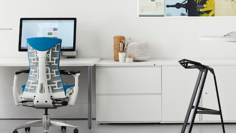 White Tu Storage cabinets and lateral files shown with a blue Embody office chair in an open workstation.