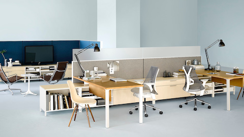 An open, shared workspace outfitted with Canvas Office Landscape workstations and storage. Select to learn more about this comprehensive furniture system.