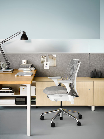 Gray Sayl chair with gray fabric seat at a Canvas Office Landscape individual workstation. Select to go to our individual workstations page.