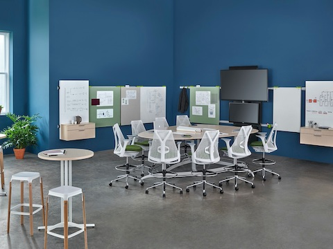 An open collaborative space with gray Mirra 2 Stools and Exclave table. Select to go to our collaborative furniture page.