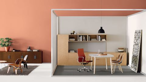 A private office with an orange Eames Aluminum Group chair and Canvas Office Landscape storage. Select to go to our private offices page.