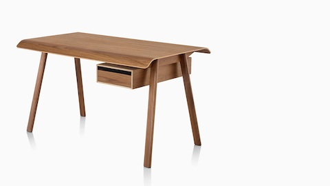 A Distil Desk in a medium wood finish. Select to go to our desks page.
