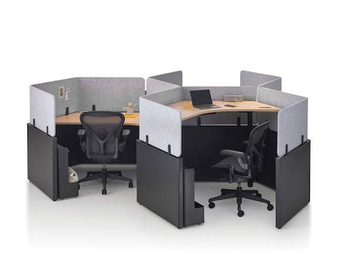 A group of Catena Office Landscape workstations in a honeycomb configuration with Ode Lamps and black Aeron Chairs.