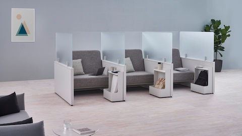 Catena Office Landscape components form three small soft seating spaces enclosed with glass screens and Ubi Mobile Bag Catch accessories.