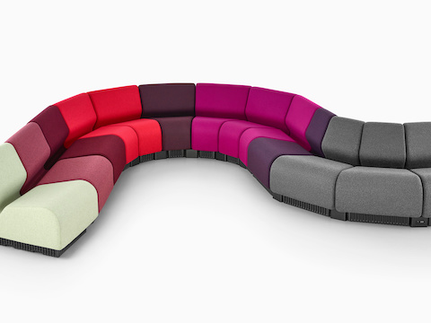 Chadwick Modular Seating modules in gray and various shades of red and purple, arranged in a serpentine configuration.
