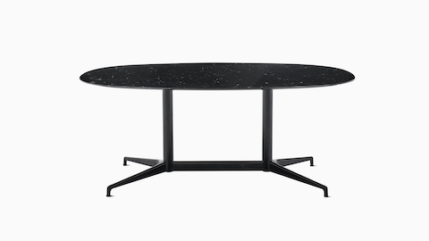 An oval Civic Table with a black marble top and black understructure.