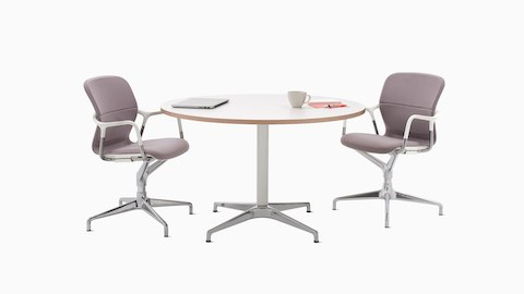 A round white Civic Table with two purple Keyn Chairs.