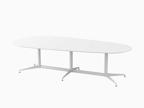 A large white trapezoid Civic Table with white legs.