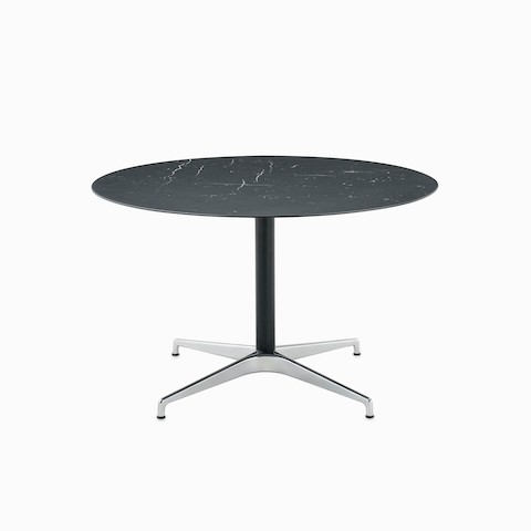 A round Civic Table with a black marble top.