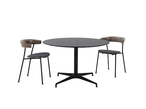 An all black, round Civic Table with two walnut Leeway chairs alongside. Select to go to the Civic Tables specs page.