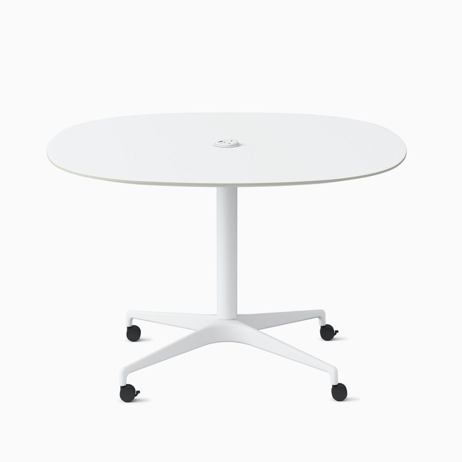 A soft square white Civic Table at work height with a centrally placed power solution.