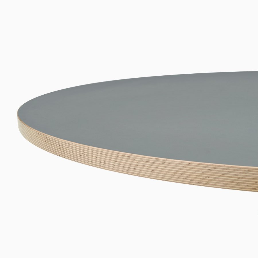 A close up view of a grey Civic Table top with a wooden square edge.