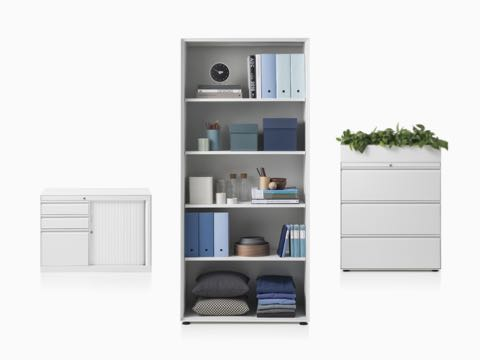 A CK8 right-hand return cabinet with shutter door compartment, CK8 open shelf high cabinet fill in with full storage item, and CK8 three-high lateral filing mid-height cabinet with planter on top.