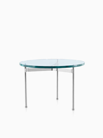 A round Claw Table with a glass top. Select to go to the Claw Table product page.