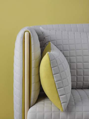 Close view of the arm detail on a light gray ColourForm sofa.