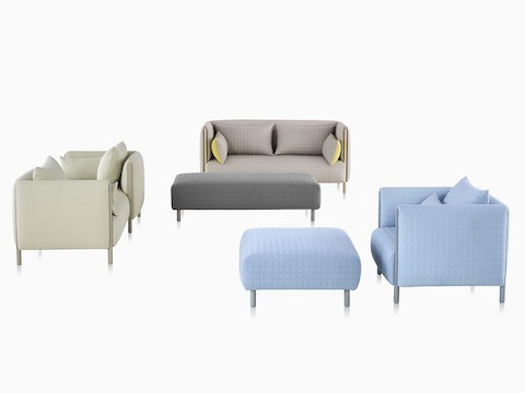 ColourForm seating pieces, including a loveseat and lounge chair, two ottomans, and a tête-à-tête formed from two modules.