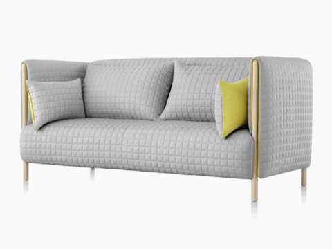 Angled front view of a light gray ColourForm sofa.