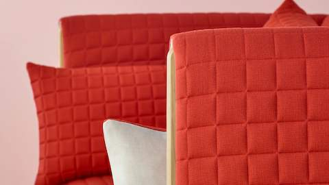 Close view of a red fabric on a ColourForm seating piece.