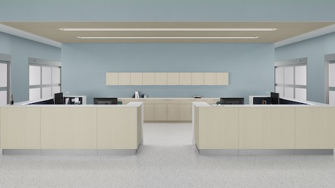 A prefab Commend Nurses Station with gray-beige patterned laminate fronts positioned within an inpatient clinic with Mora System.