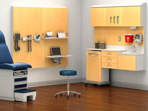 Modular healthcare components from the Compass System provide storage and support technology in an exam room.