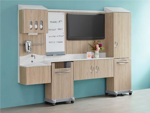 A light wood finish Compass System footwall in patient room setting.