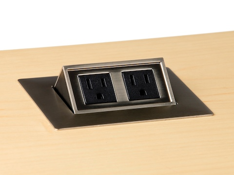 A two-outlet Connect power port mounted into a woodgrain work surface.