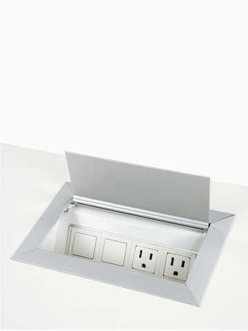 A Connect Power and Data port mounted into a work surface.