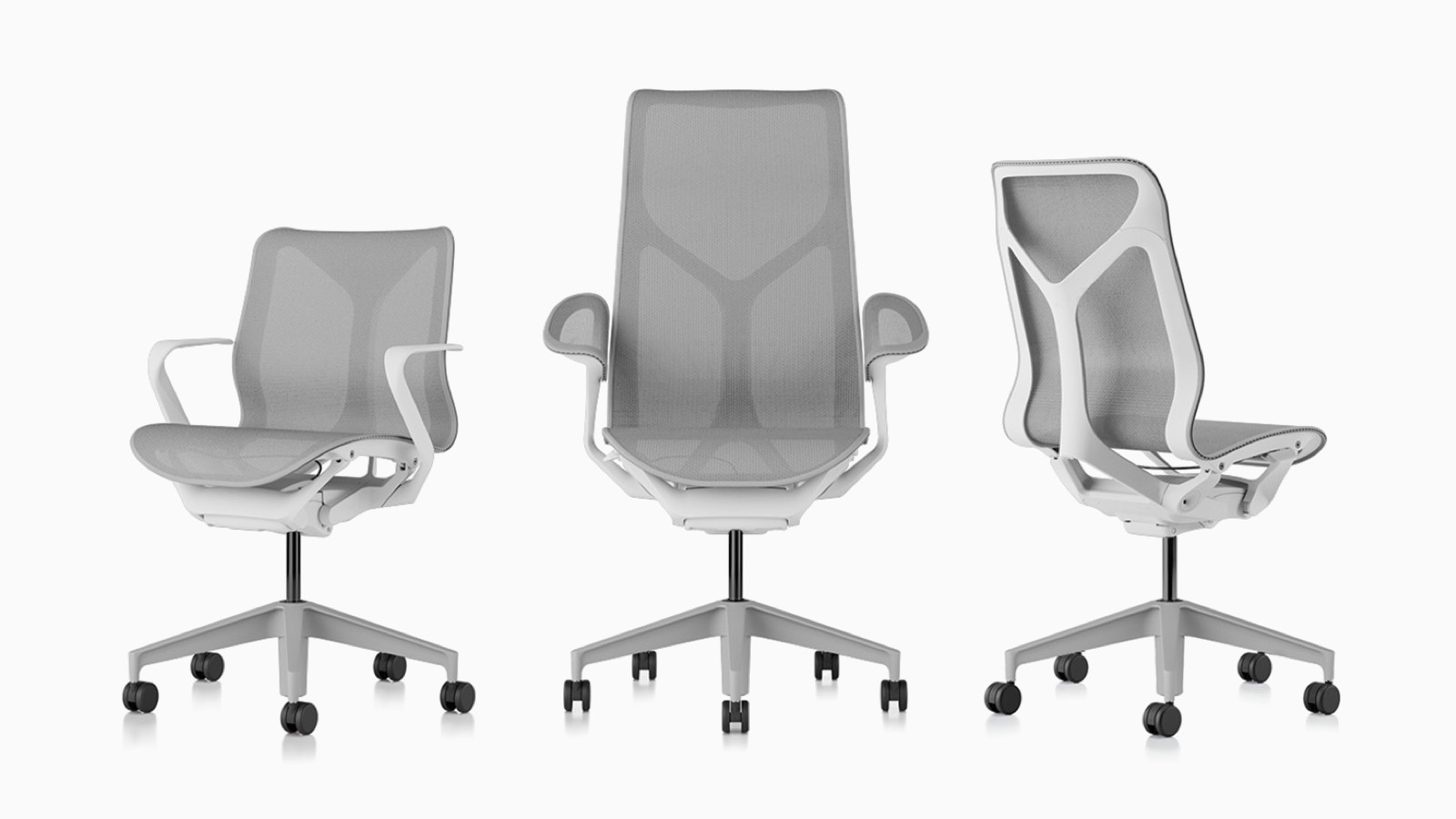 Low-back, high-back, and mid-back Cosm ergonomic desk chairs with bases and frames in Studio White and suspension materials in Mineral light grey.