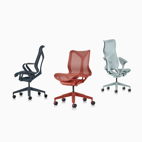 A grouping of Nightfall navy blue, Canyon red, and Glacier light blue Cosm Chairs.
