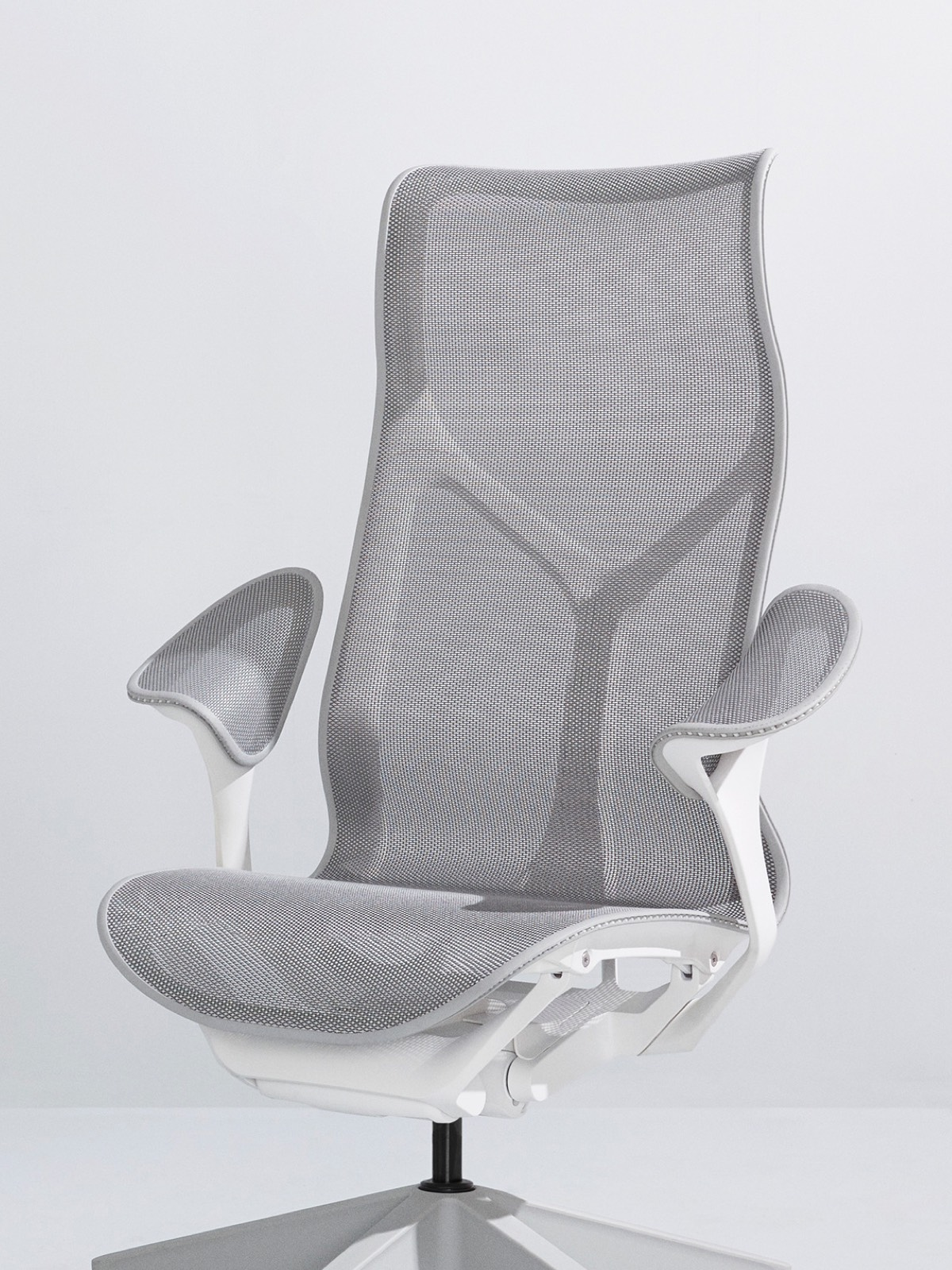 A Mineral grey high-back Cosm Chair with a white frame and leaf arms on a light grey background.