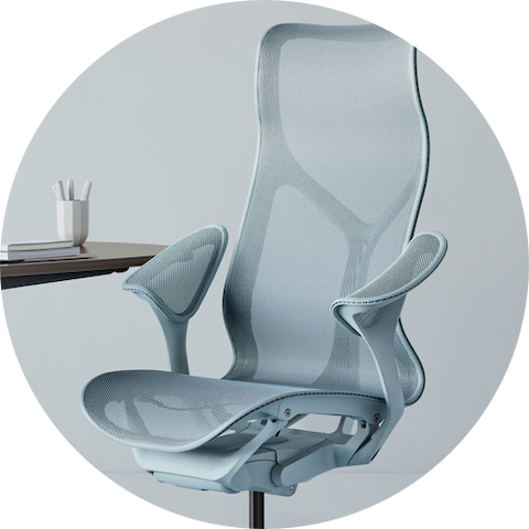 Cosm high-back chair in light blue at a table.