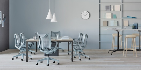 Glacier light blue Cosm Chairs around a table in an office.