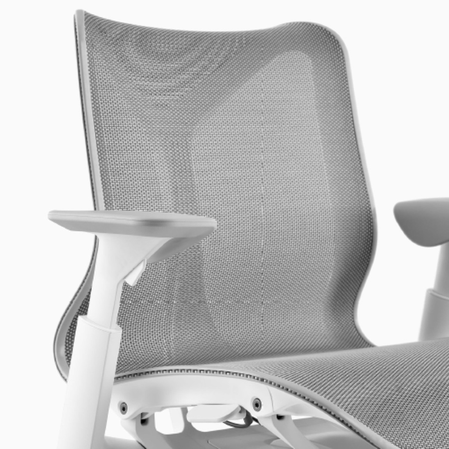 A low-back Cosm Chair with height-adjustable arms and Studio White frame and Mineral suspension material.