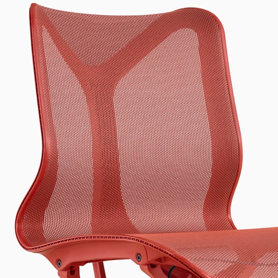 A low-back Cosm Chair with no arms and a Canyon red frame and suspension material.