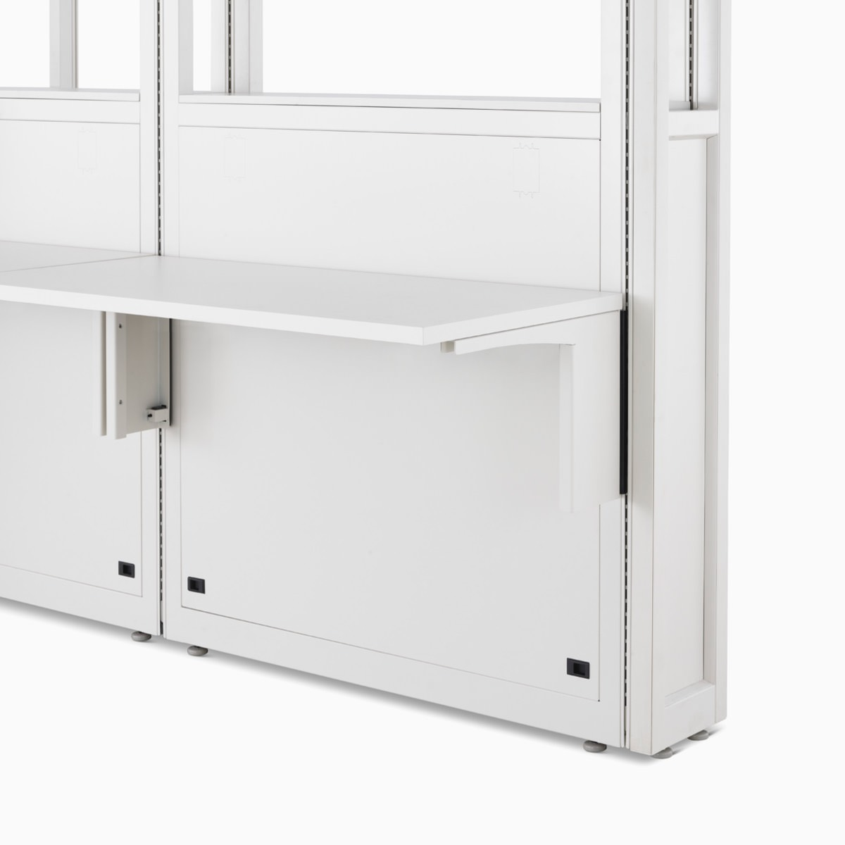 Detail of Co/Struc System module with work surfaces in soft white.