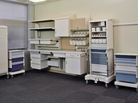 A collection of movable, modular Co/Struc System storage components in a clinical setting.