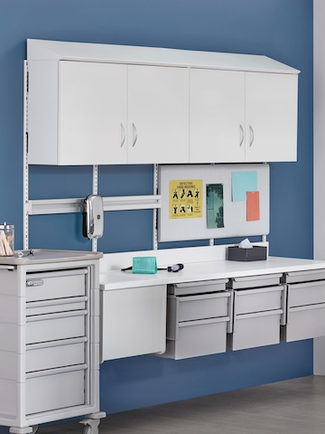 Modular components from the Co/Struc System, including lower drawer units and overhead cabinets with transparent doors.