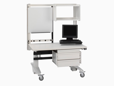 A mobile Co/Struc System clinical cart supports a monitor and keyboard.